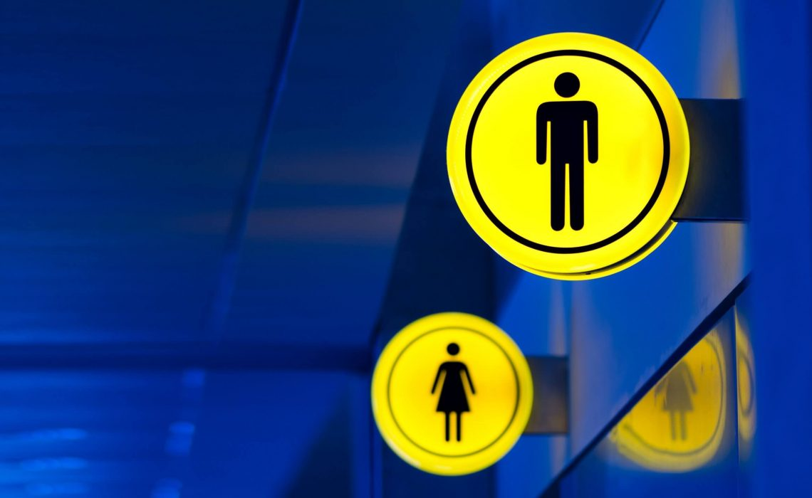 Male, female toilet, restroom sign. Man and woman equality concept. Copy space. Banner